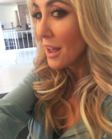 Brandi Love taking a selfie